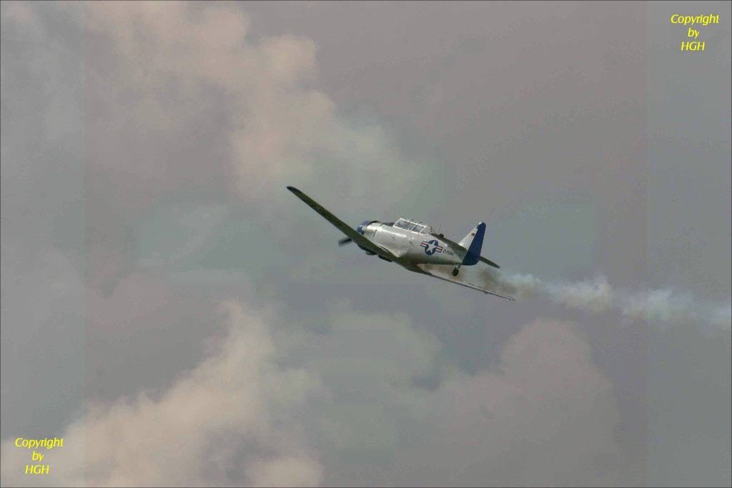 Harvard T6  in the clouds